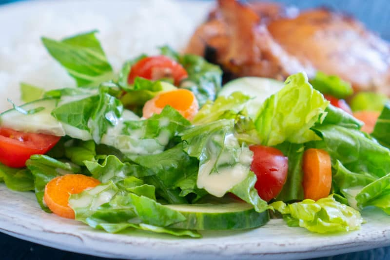 close up of romaine salad with creamy teriyaki salad dressing