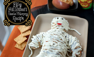 This Halloween Cheese Ball Mummy will be the hit of your Halloween party food. Easy to make and so cute! | EatingRichly.com