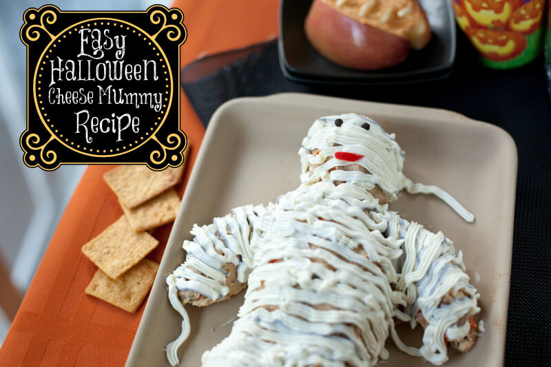 This Halloween Cheese Mummy will be the hit of your Halloween party food. Easy to make and so cute! | EatingRichly.com