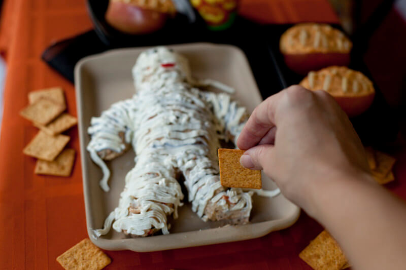 This cute cheese mummy is surprisingly easy to make and the perfect savory treat for your Halloween party. From EatingRichly.com