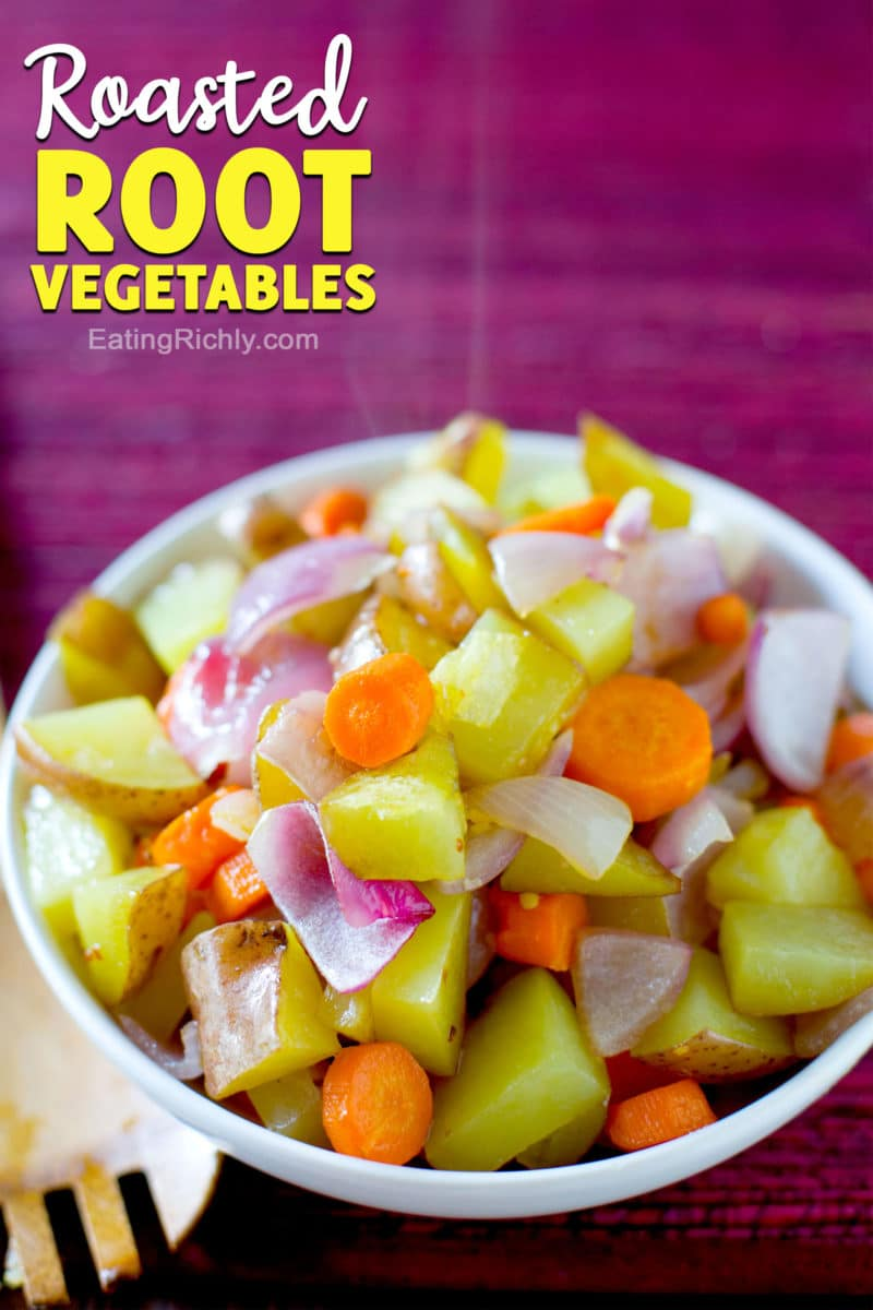 Bowl of steaming hot potatoes carrots red onion and garlic with text reading Roasted Root Vegetables