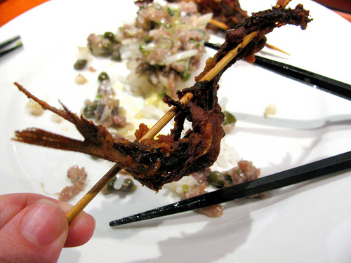 The fried sardine from the ninth course.