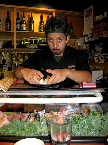 Hajime Sato preparing sushi