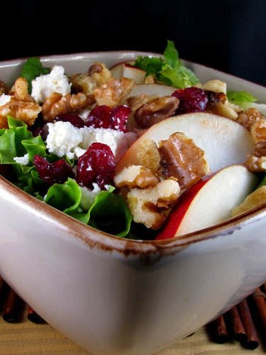 Pear, candied walnut, cranberry and feta salad with citrus dressing.