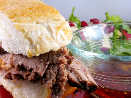 Beef Aju Sandwich made from a beef bottom roast in the crockpot with an autumn harvest salad
