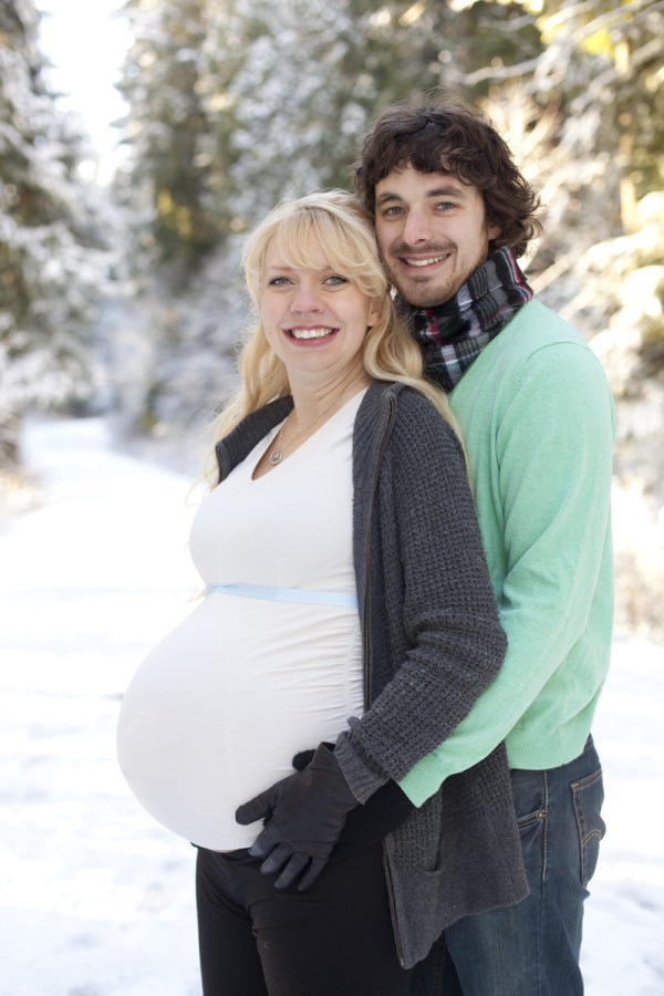 pregnant couple snow