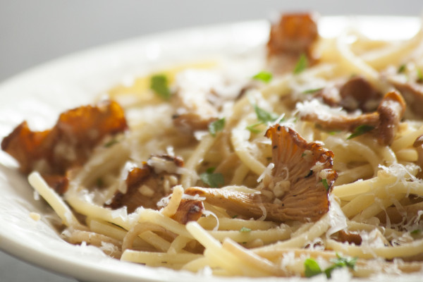 Easy recipe for Chanterelle Mushrooms. Just Chanterelles, pasta, butter, parmesan and parsley.   EatingRichly.com