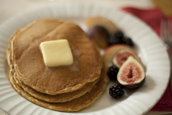 Fluffy whole wheat pancakes so light and airy, you won't believe they're healthy! | EatingRichly.com