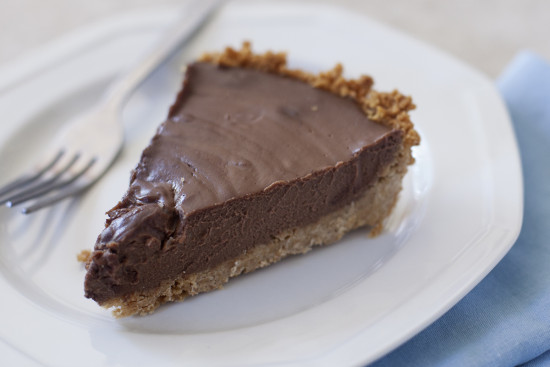 This rich, creamy, decadent chocolate coconut pie is dairy free, and easily gluten free or vegan as well. | EatingRichly.com