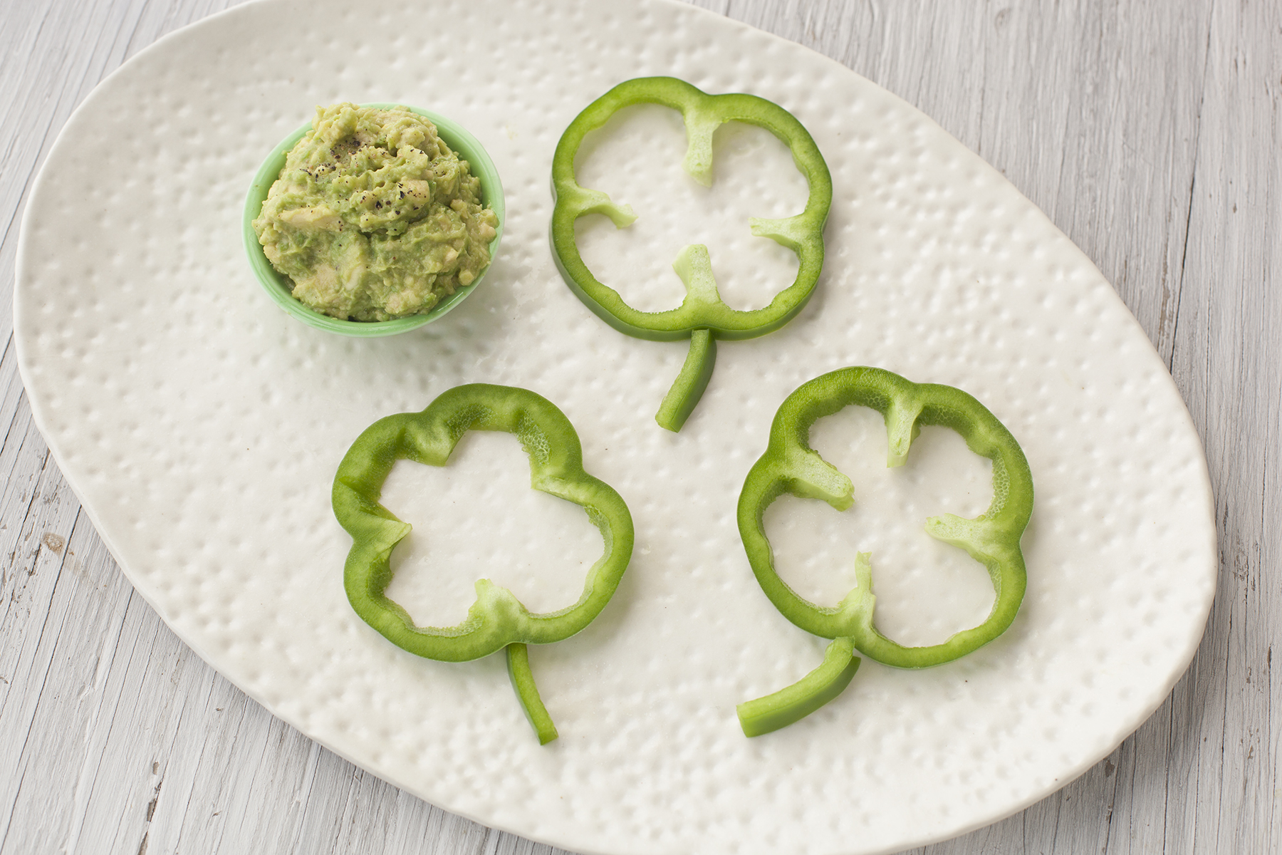 Healthy St. Patrick's Day Snack Bell Pepper Shamrocks with Avocado Dip
