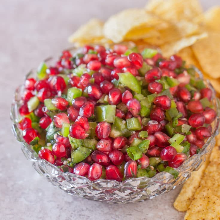 This fresh pomegranate salsa recipe is always tasty, but it's especially fun for Christmas parties with it's beautiful bright red and green colors. From EatingRichly.com
