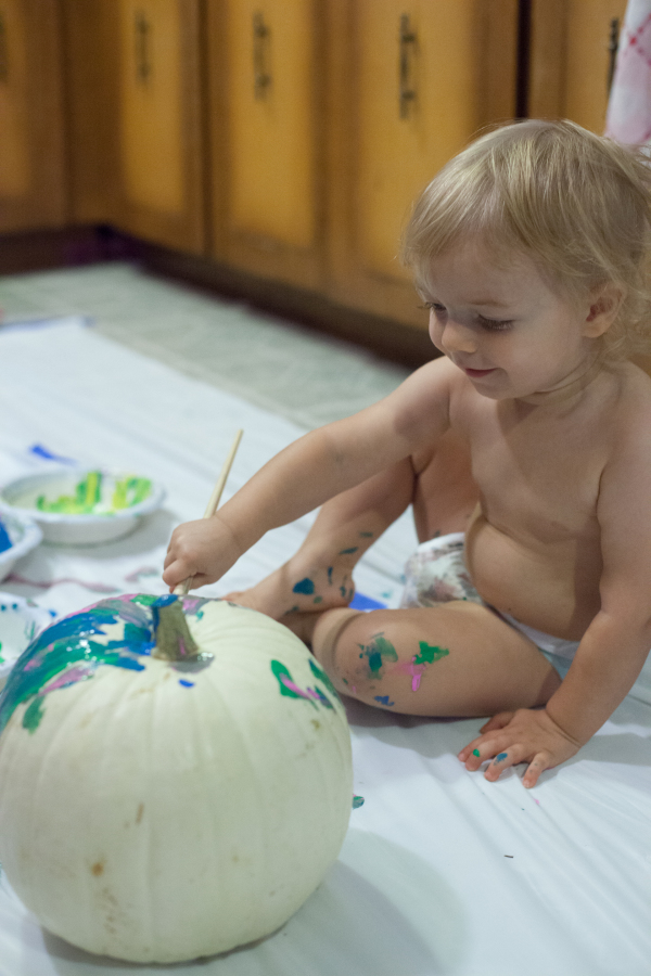 Painting a pumpkin is a great Halloween activity for toddlers. EatingRichly.com