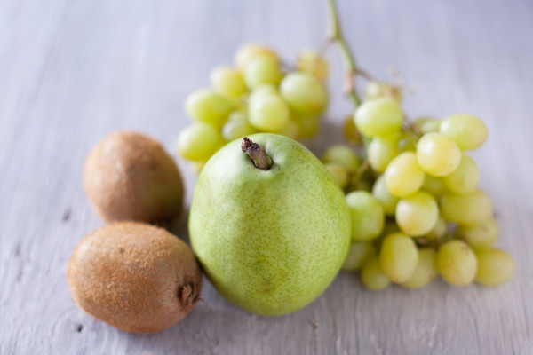 This simple fruit salad uses green kiwi, pear, and grapes. Perfect for a cute St. Patrick's Day kid snack! - EatingRichly.com