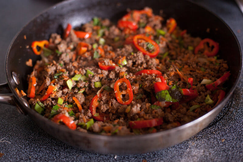 Thai ground beef recipe cooking in a skillet