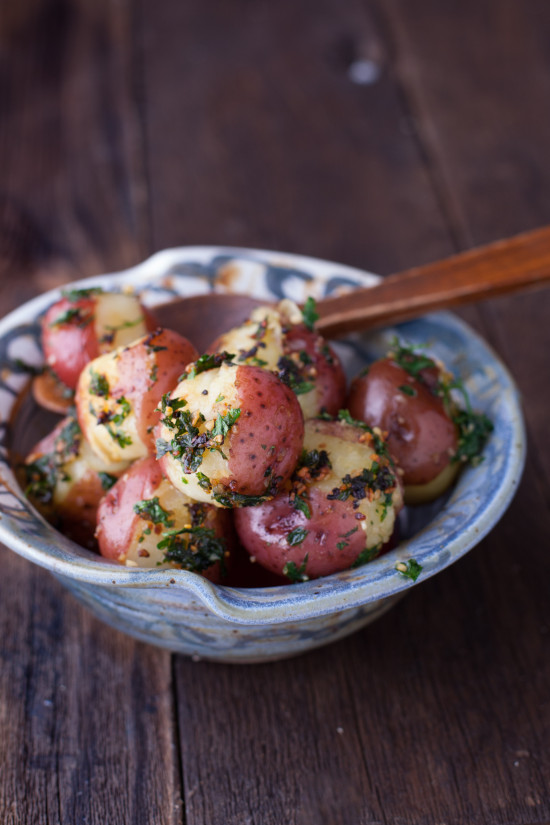 This easy new potatoes recipe is flavored with fresh garlic and parsley and ready in just 30 minutes. From EatingRichly.com