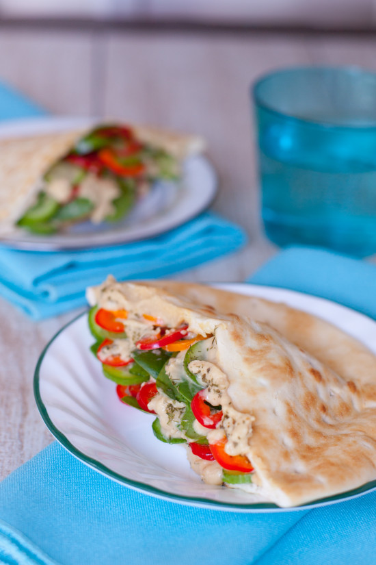 These simple vegetarian pita sandwiches are packed with fresh veggies & hummus, making them the perfect easy healthy breastfeeding recipe for new moms. From EatingRichly.com