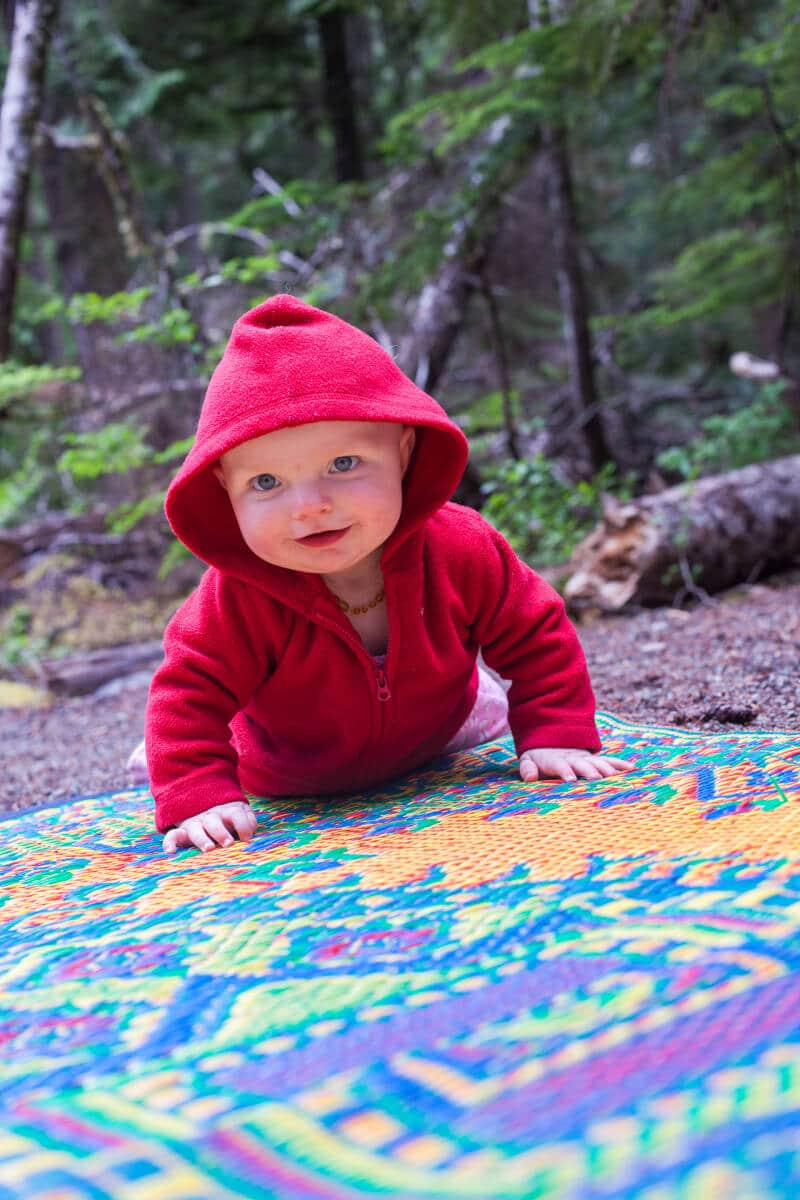 25 tips for camping with toddlers and babies - Baby crawling on mat