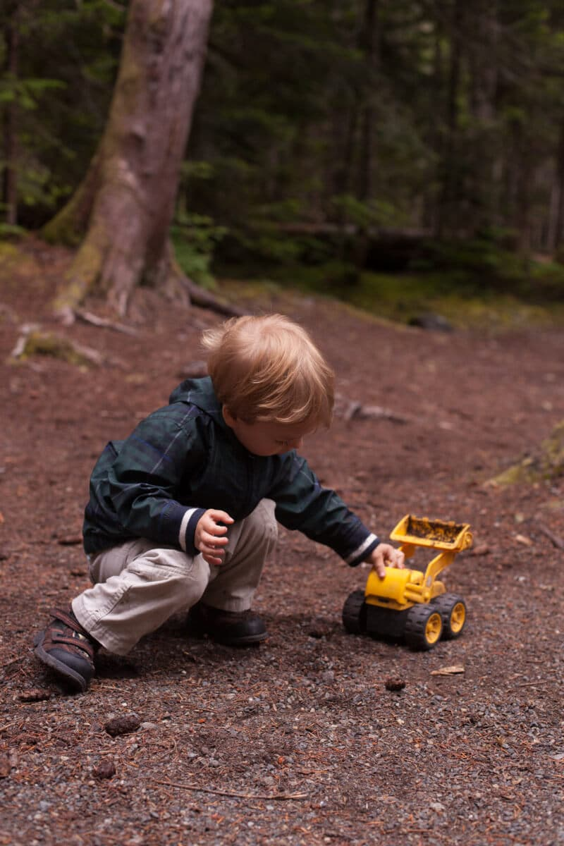25 tips for camping with toddlers and babies-Playing with a truck in the woods