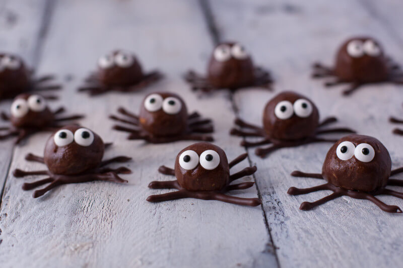 These cute little spiders are actually a chocolate peanut butter protein ball, perfect for some quick energy or an adorable healthy kid snack for Halloween. From EatingRichly.com