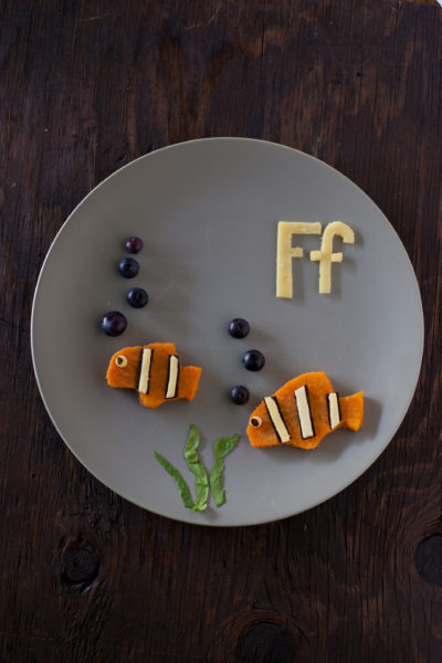 Sweet potato fish are part of our Alphabet Kid Snack series of healthy toddler snacks that make learning fun. Your child will love this cute kid snack! Get more cute kid snacks at EatingRichly.com
