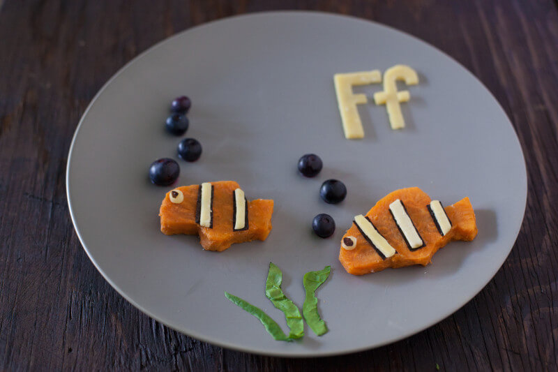 Sweet potato fish are part of our Alphabet Kid Snack series of healthy toddler snacks that make learning fun. Your child will love this cute kid snack! From EatingRichly.com
