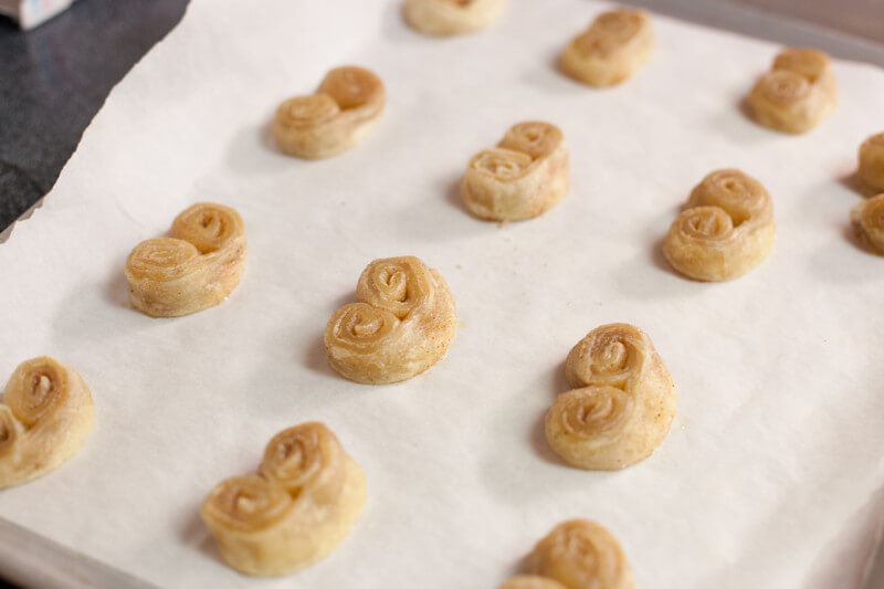 Palmiers are easy French pastries made from puff pastry dough. So simple, my toddler demonstrates how to make them. Try this recipe with your kids today! Part of #MiniChefMondays on EatingRichly.com