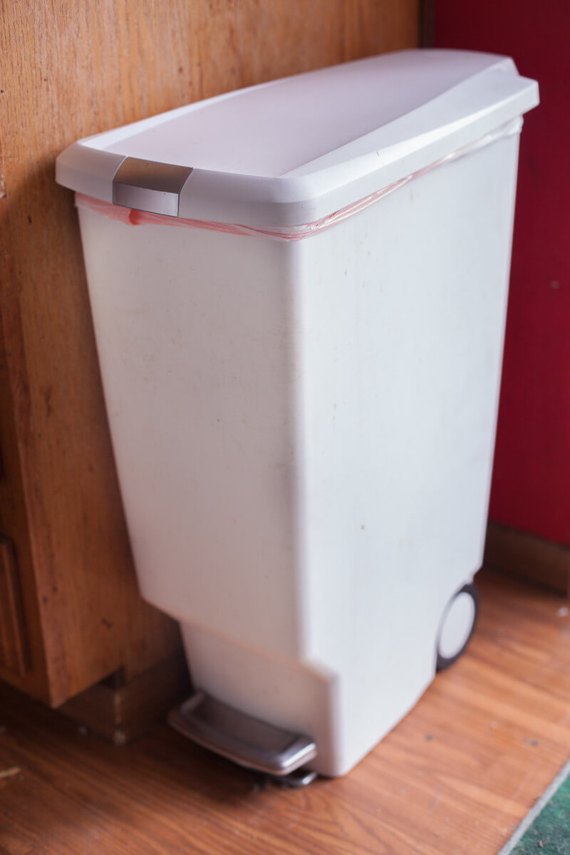 Our favorite kitchen garbage can has a slim profile, foot pedal, and a lock. Perfect for small kitchens. From EatingRichly.com