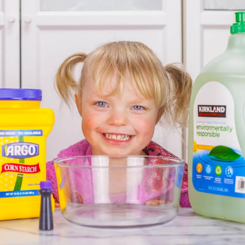 Girl with cornstarch, dish soap, and food coloring for silly putty recipe
