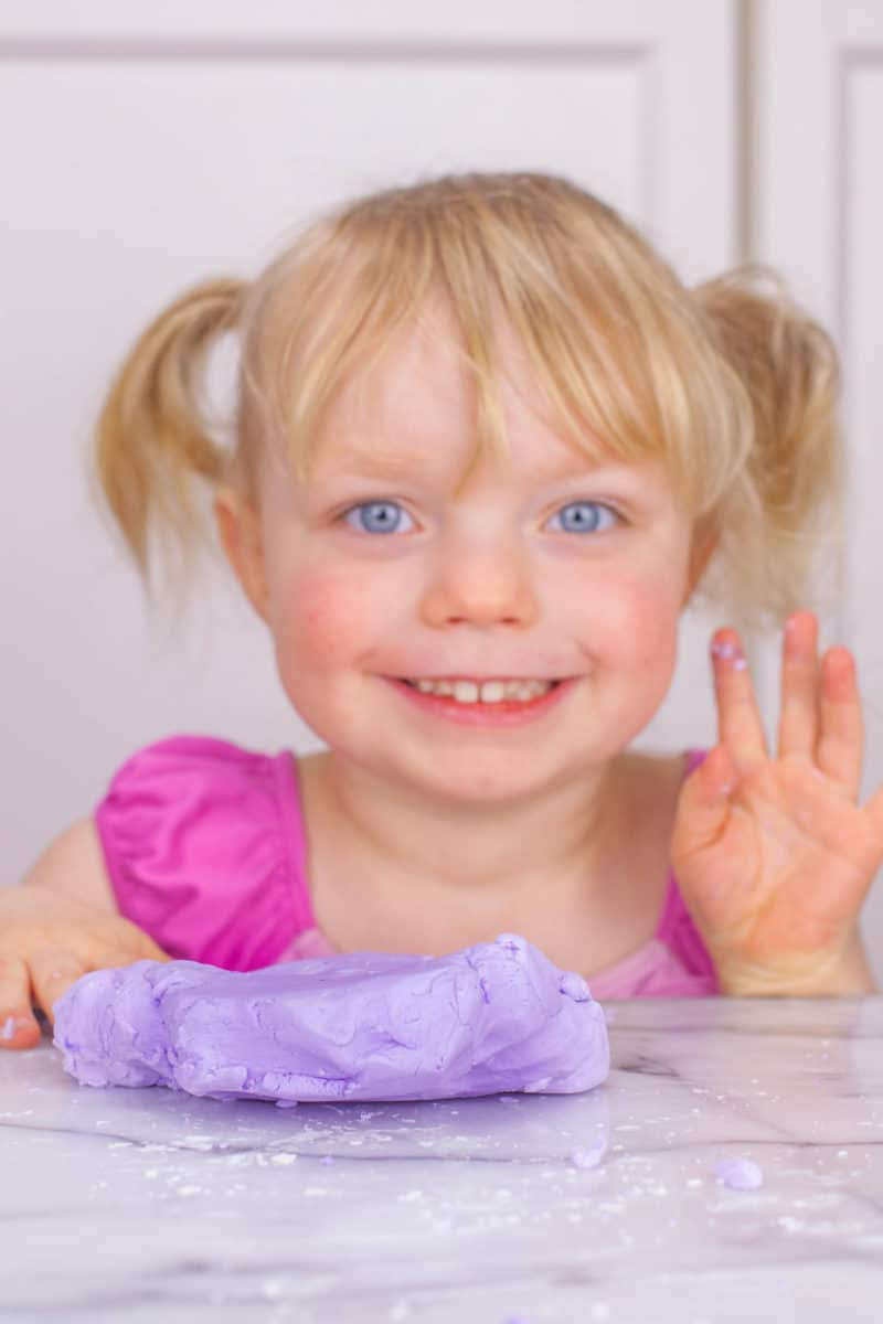 Girl smiling with purple silly putty