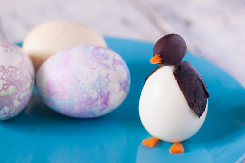 Wondering what to do with Easter eggs now that you're done with Easter? Turn them into these cute and easy boiled egg animals! Make this penguin in about two minutes. This plus three more boiled egg animals at EatingRichly.com