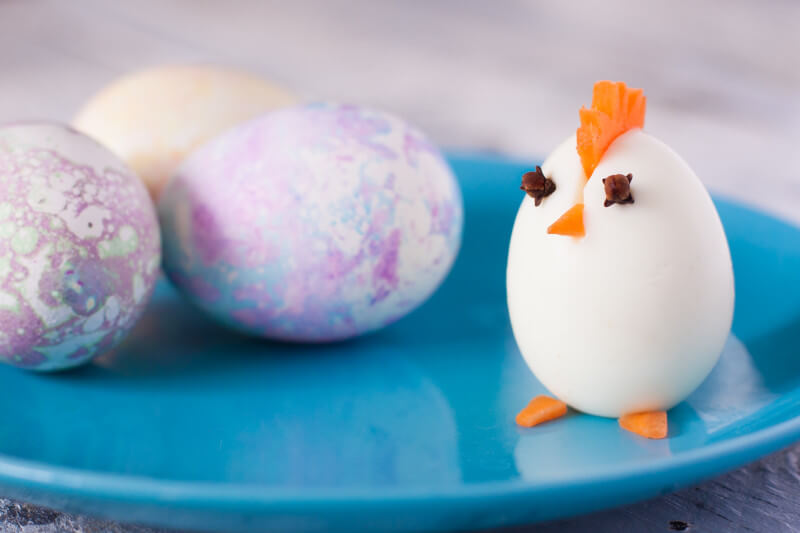 Wondering what to do with Easter eggs now that you're done with Easter? Turn them into these cute and easy boiled egg animals! Make this chick in about two minutes. This plus three more boiled egg animals at EatingRichly.com