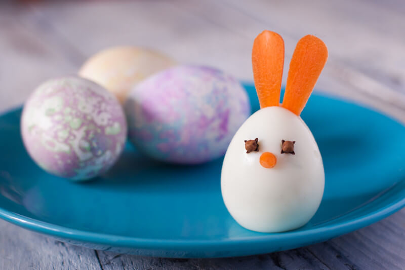 Wondering what to do with Easter eggs now that you're done with Easter? Turn them into these cute and easy boiled egg animals! This bunny takes just two minutes to make. From EatingRichly.com