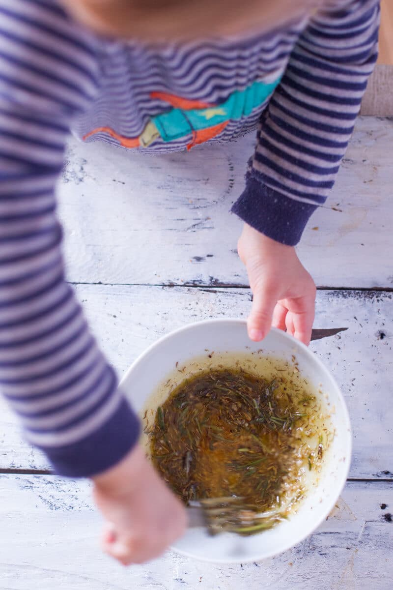 Child stirring marinade for easy lamb chops recipe