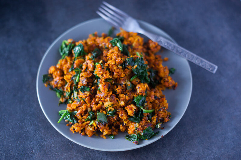 This colorful paleo sweet potato hash recipe has just four ingredients, and packs a nutritional punch that makes it a fantastic side dish for breakfast, lunch, or dinner. Great paleo and vegan St. Patrick's Day recipe! From EatingRichly.com