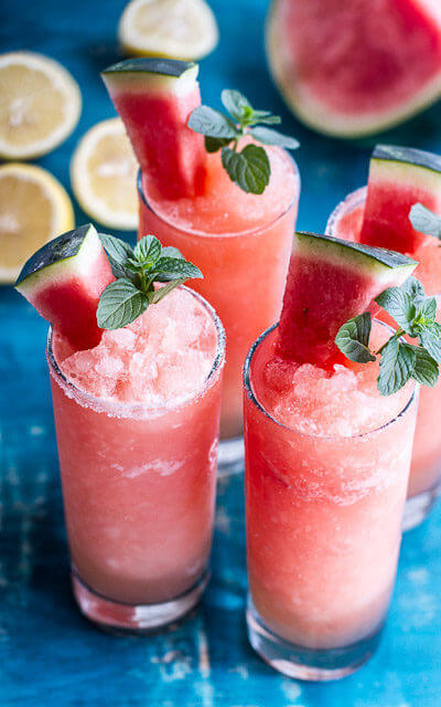 This dye-free pink lemonade slushy looks like summer in a tall frosty glass. Check out all 20 booze free Mother's Day drinks on EatingRichly.com