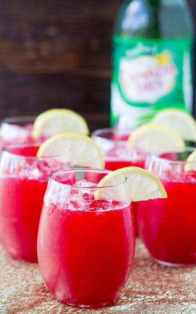 This raspberry lemonade fizz uses strained raspberry syrup made with frozen raspberries. Check out all 20 booze free Mother's Day drinks on EatingRichly.com