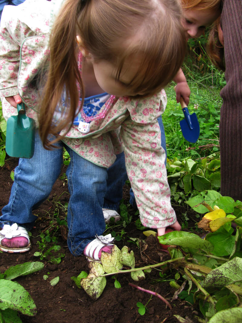 It's so exciting for kids to dig up underground veggies like carrots or potatoes. Get more tips for growing a kids vegetable garden at EatingRichly.com