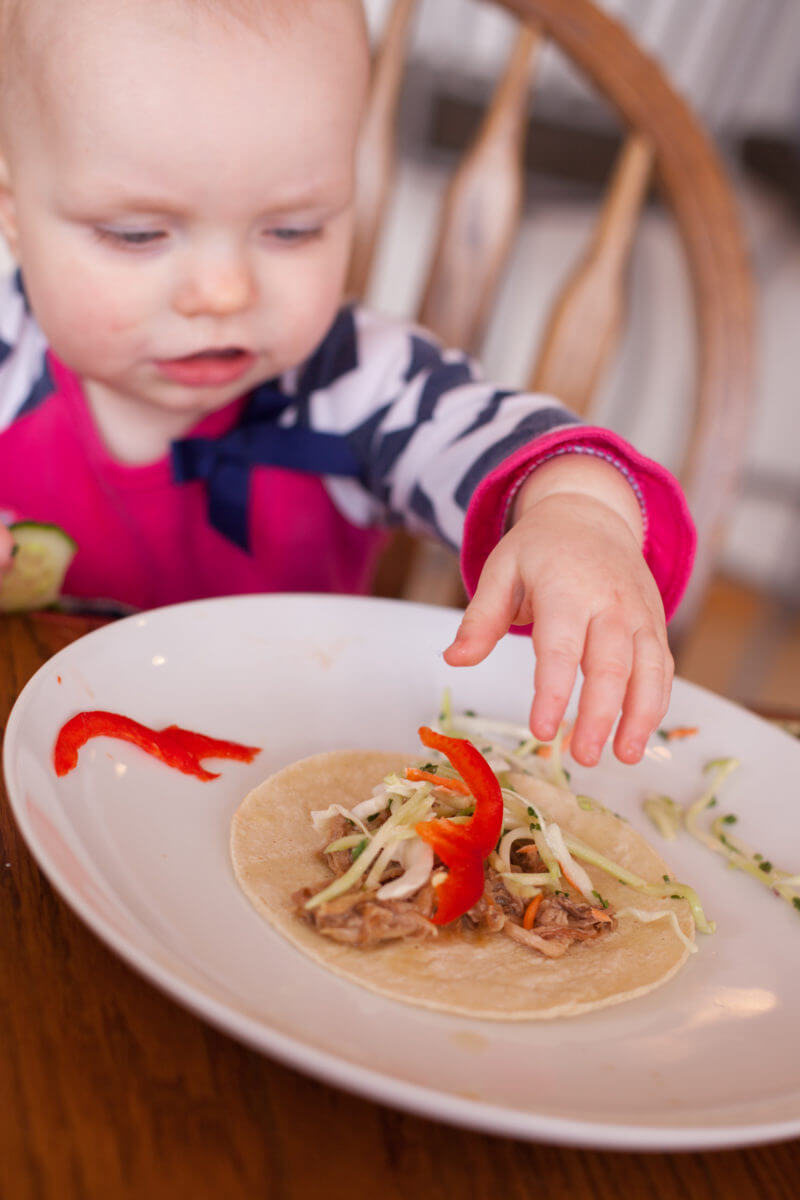Baby making Korean tacos for dinner. Get the recipe at EatingRichly.com
