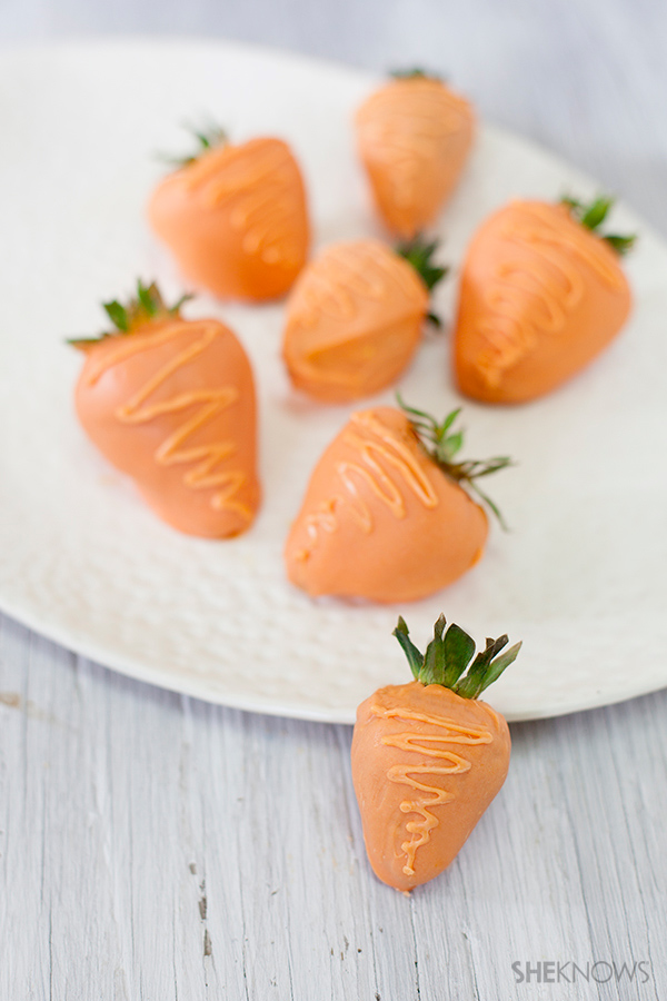 Tickle mom's funny bone with chocolate covered strawberries that look like carrots! Check out all ten cute edible Mother's Day gifts at EatingRichly.com