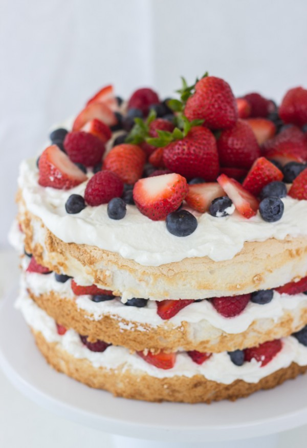 Angel-food cake with coconut whipped cream and berries. Get more recipes for healthy 4th of July desserts at EatingRichly.com.