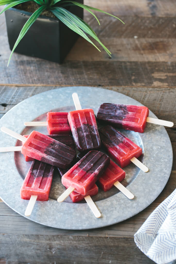 Mixed berry popsicles. Get more recipes for healthy 4th of July desserts at EatingRichly.com.
