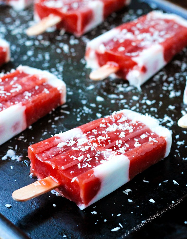 Strawberry Rhubarb Coconut Milk Popsicles. Get more recipes for healthy 4th of July desserts at EatingRichly.com.