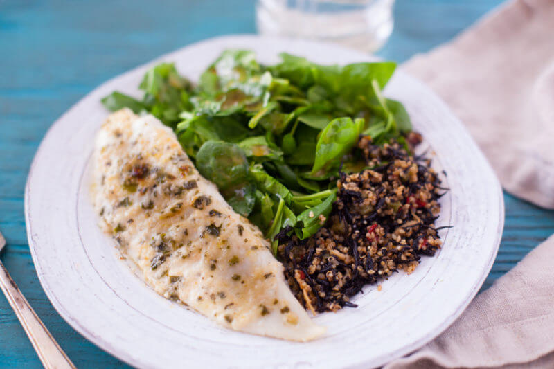 Hands down the best tilapia recipe ever. Flavorful lemon parmesan tilapia is quickly broiled for a delicious tilapia recipe that's 15 minutes start to finish! From EatingRichly.com