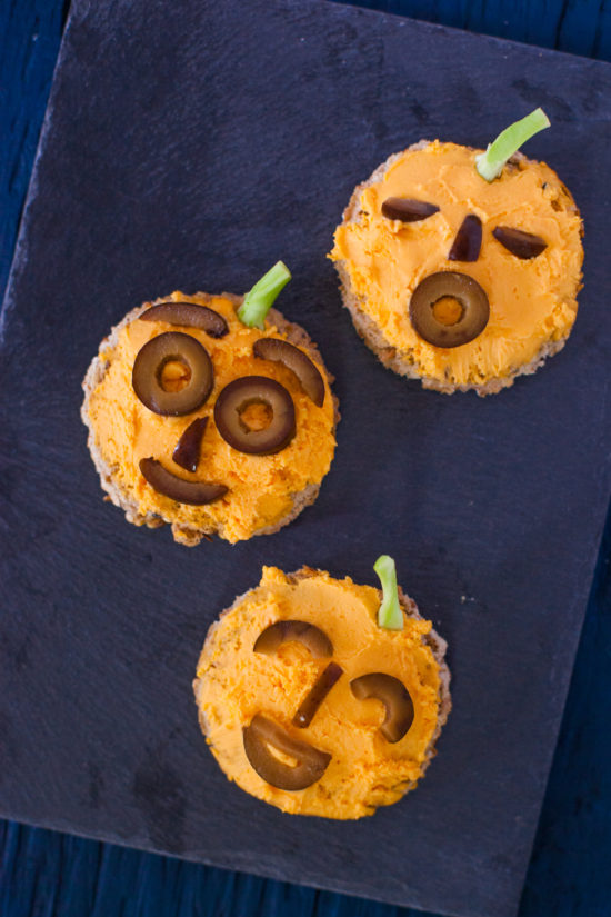 Holiday edible art projects for kids: jack o'lantern toasts from EatingRichly.com