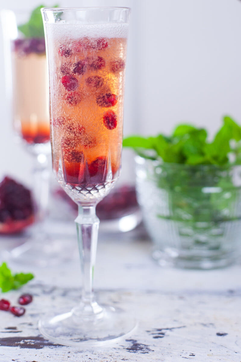 This pomegranate mint champagne cocktail will wow your holiday party guests, and is easy to set up as a DIY cocktail bar so YOU can focus on socializing. From EatingRichly.com