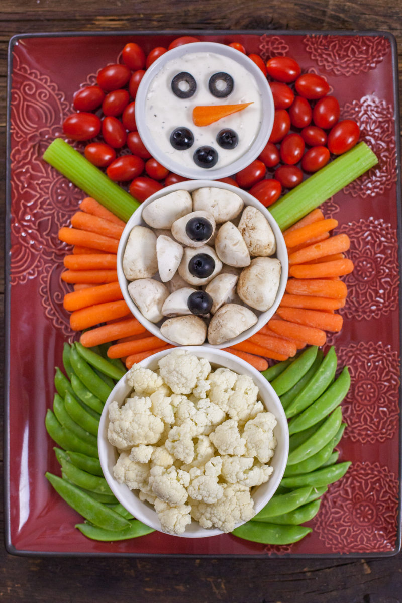this christmas veggie tray snowman is easy enough for kids to make and too cute