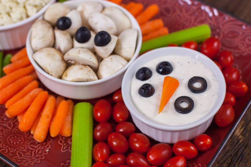 christmas veggie tray snowman eating richly