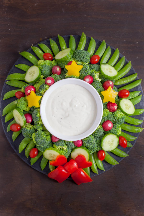This veggie wreath is a festive way to dress up your holiday appetizer. It's almost too pretty to eat. From EatingRichly.com