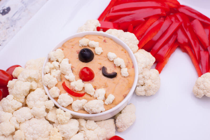 This cute Santa veggie tray is a magical way to bring some healthy options to your Christmas table. From EatingRichly.com