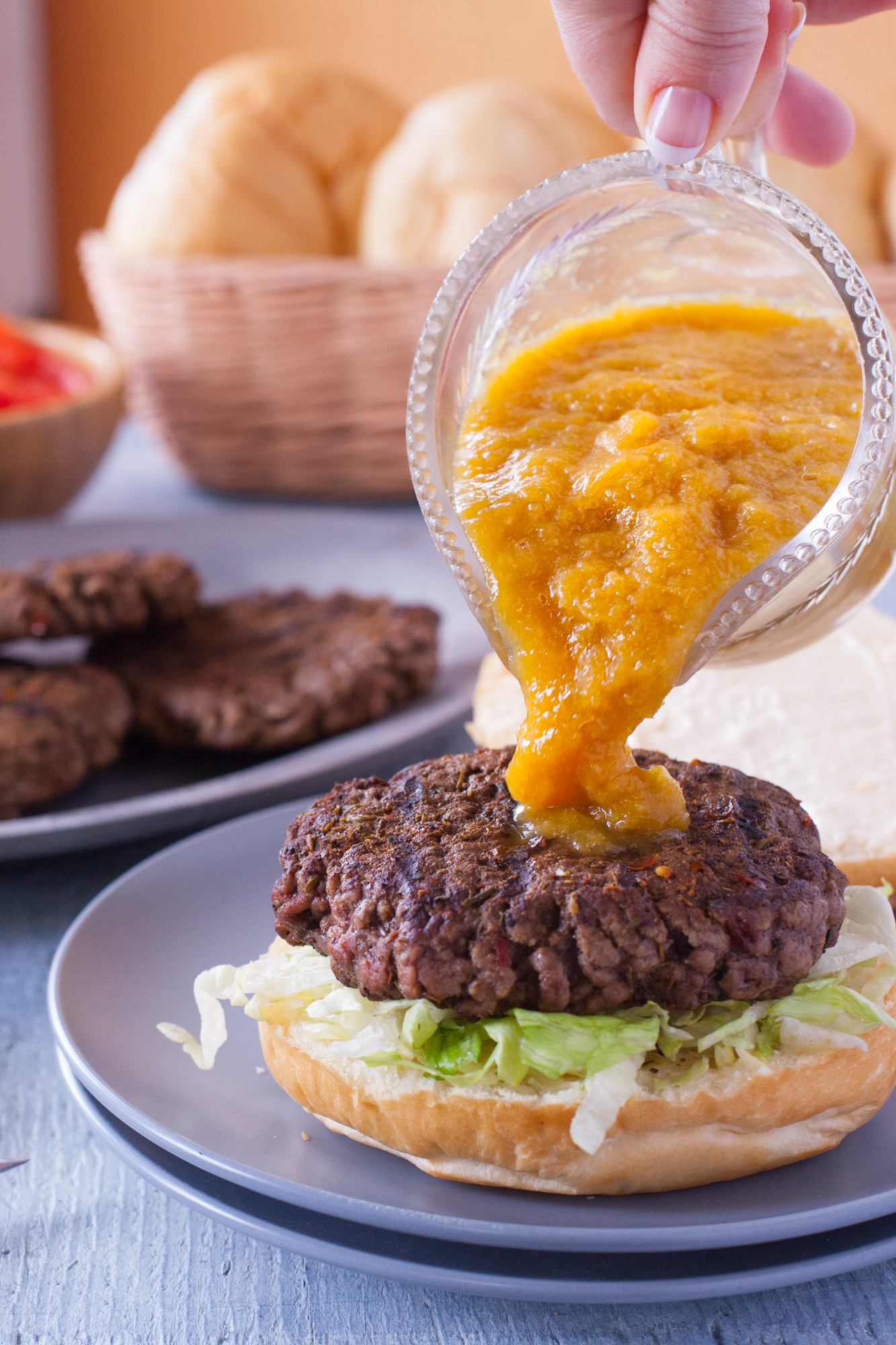 This Jamaican burger recipe will blow your mind! It's a Jamaican jerk seasoned burger topped with spicy pineapple sauce, sweet mango, and red bell pepper. It's the stuff burger dreams are made of! From EatingRichly.com